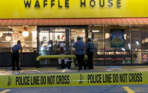 This is a picture of the Waffle House hours after the situation had taken place and the police had arrived.