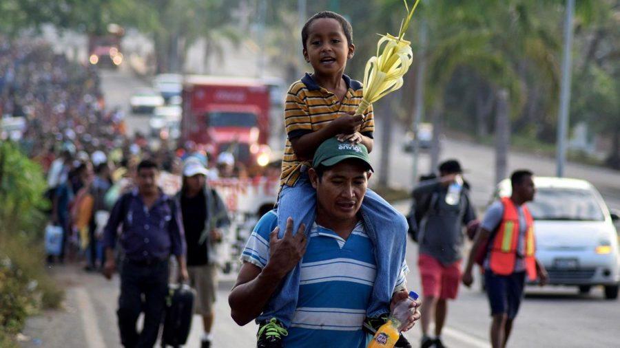 Caravan immigrants taking part in a Via Crucis