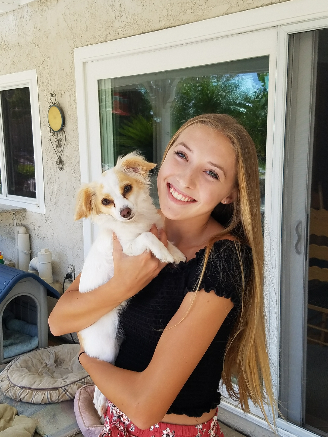 Alyssa lovingly plays with her dog Bailey at her home.
