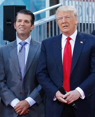 Donald Trump and his son Donald Trump Jr. speak to a crowd about building the wall.
