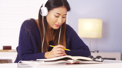 A student uses music as a tool for memorization while studying for AP tests.