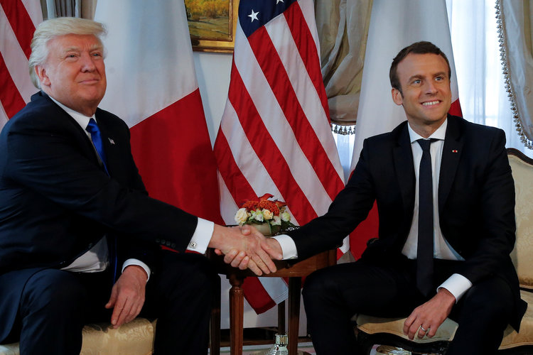 Trump and Macron shake hands before a working lunch.