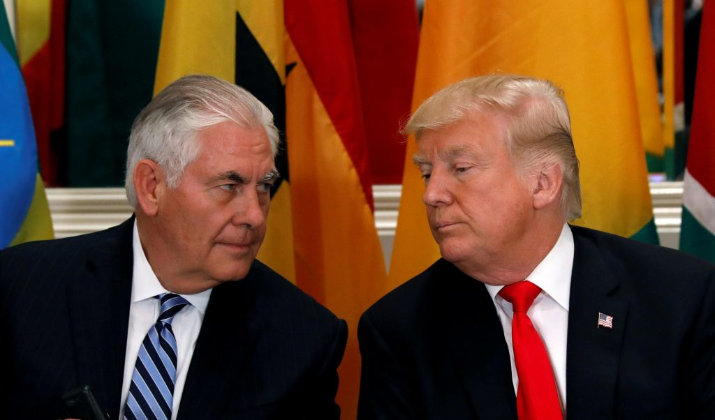 Tillerson and Trump conferring during a lunch conference.