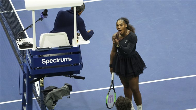 Above, Williams argues with umpire Carlos Ramos over the controversial coaching call.