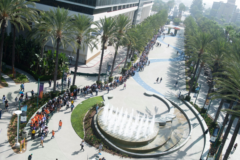 Attendees gather in front of the Anaheim Convention Center before former President Barack Obama's speech.