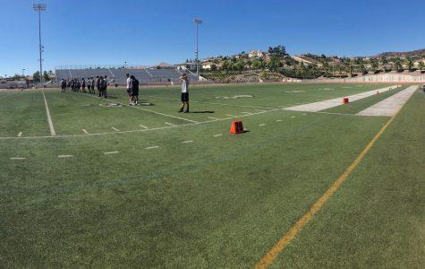 Yorba Linda High School's varsity football team practicing hard for upcoming game.