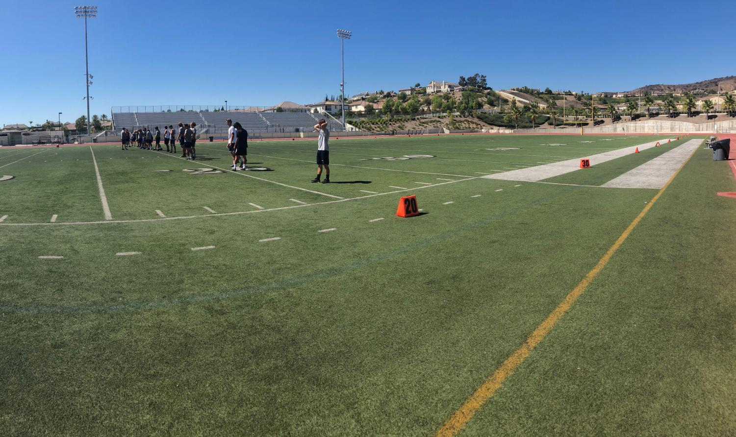 Yorba Linda High School's varsity football team practicing hard for upcoming game.