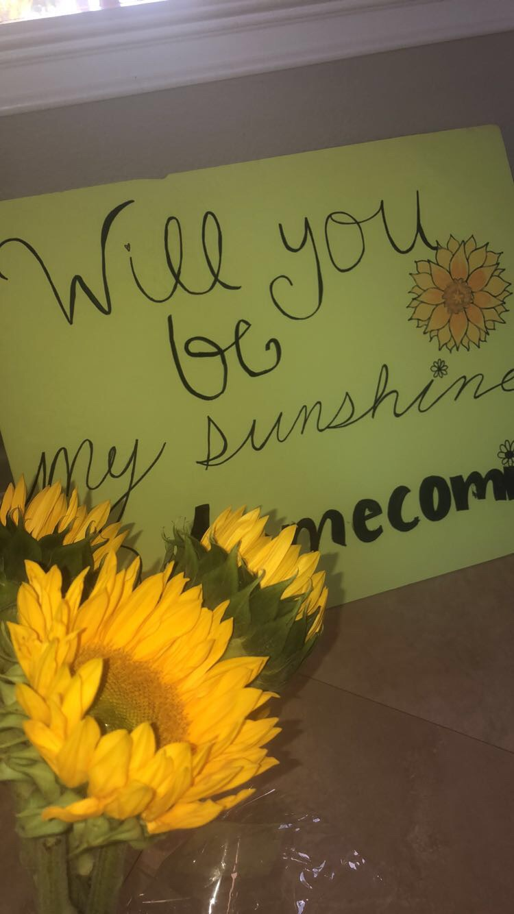 One YLHS student creatively asks his homecoming date with sunflowers and a cute poster