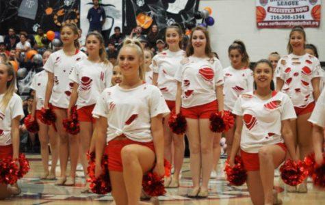 Cheer and Song Performing at the Homecoming Rally.