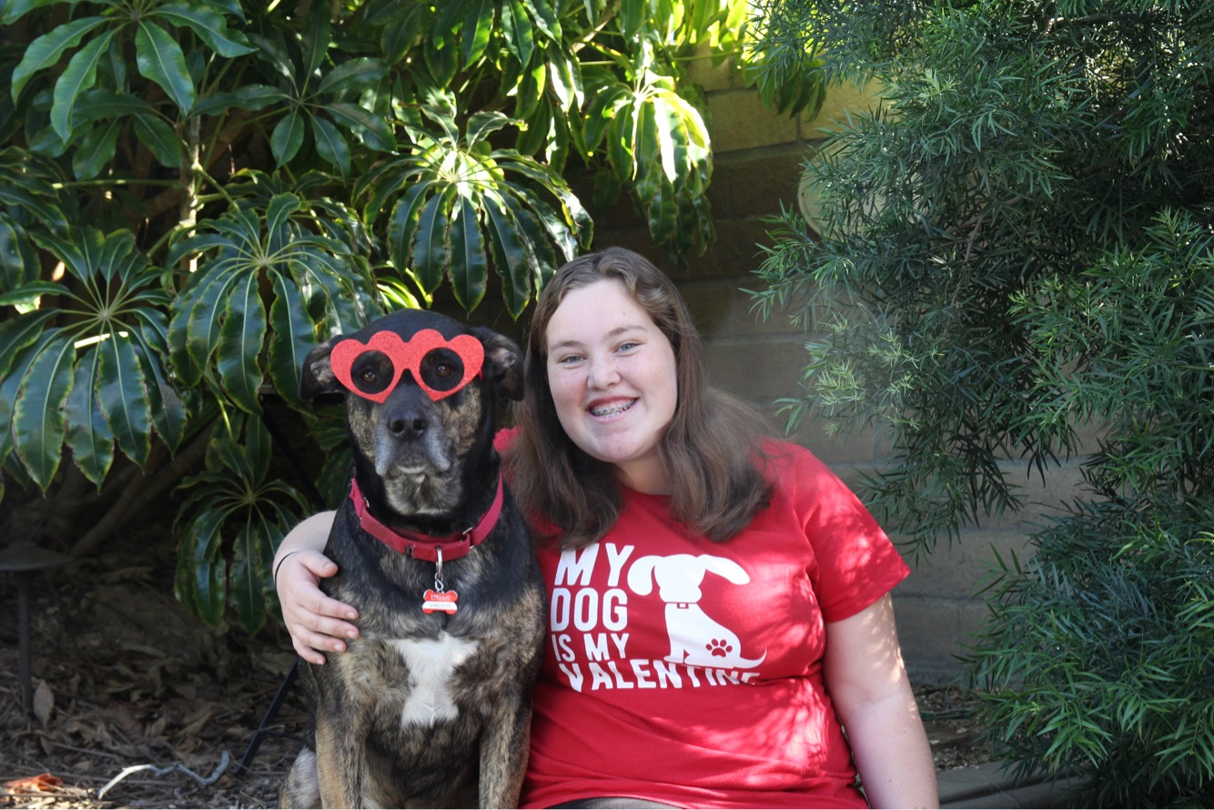 Allie and her dog posing on Valentine's Day!