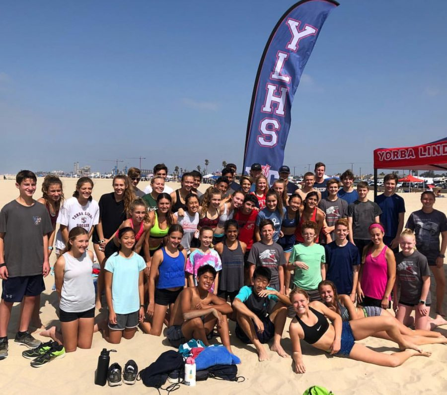 The+cross+country+team+at+their+end+of+summer+camp+beach+run.