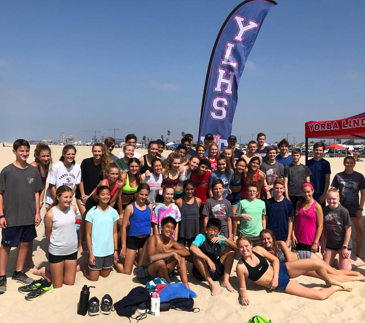 The cross country team at their end of summer camp beach run.
