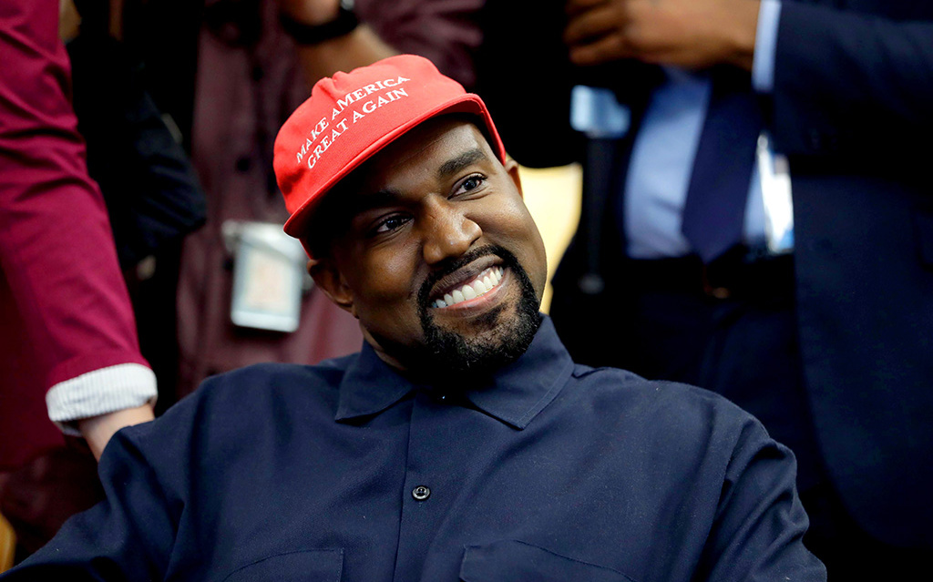 Mandatory Credit: Photo by Evan Vucci/AP/REX/Shutterstock (9927891g) Rapper Kanye West is seated while meeting with President Donald Trump and others in the Oval Office of the White House, in Washington Trump Kanye West, Washington, USA - 11 Oct 2018