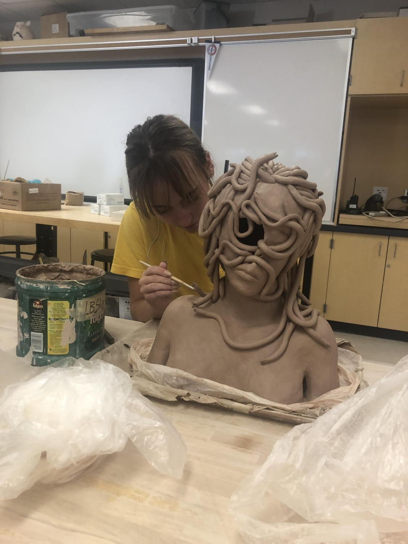 Macy Schreiber works on her Medusa bust.