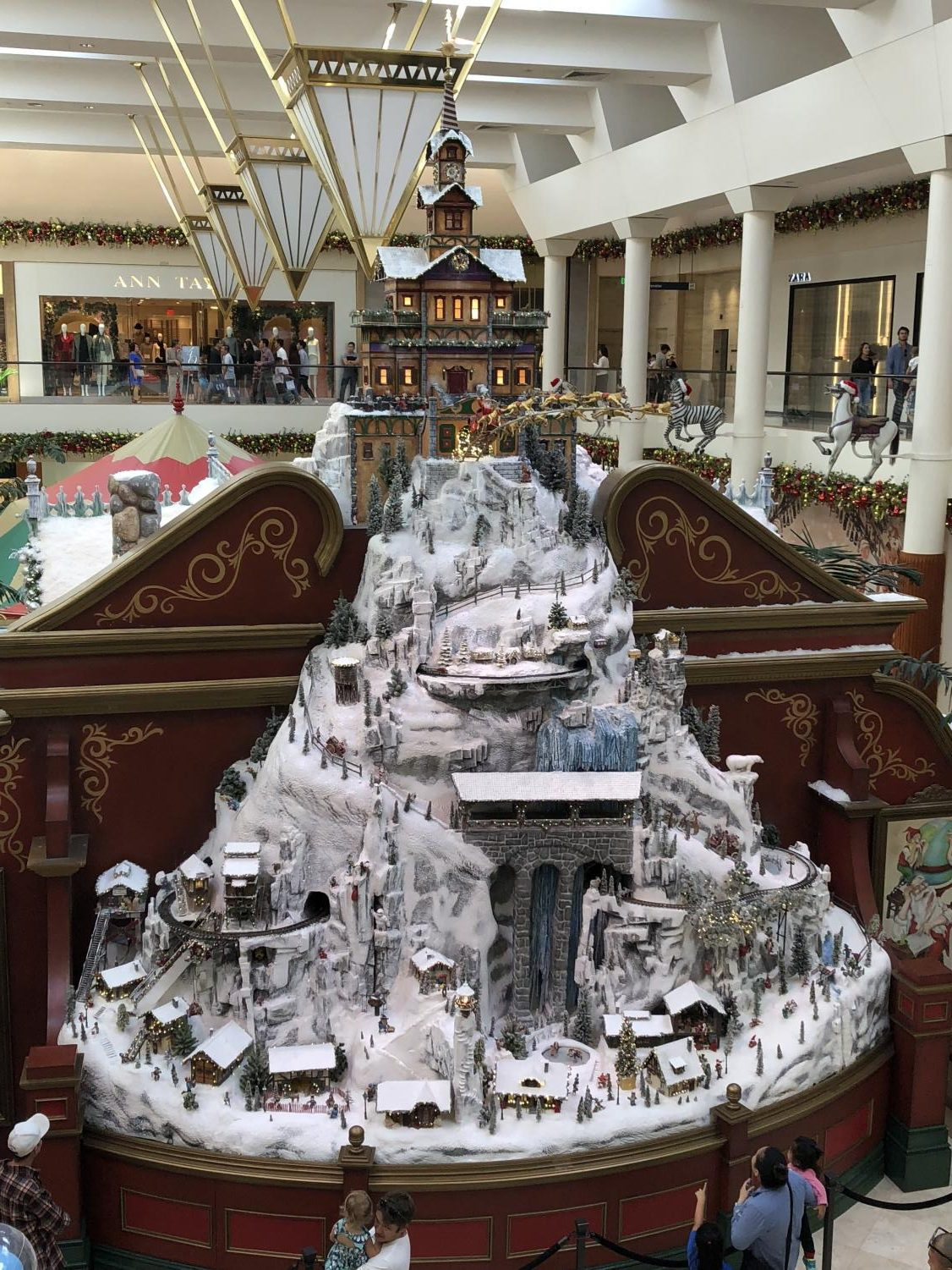 Malls, such as South Coast Plaza, lure holiday shoppers with festive decorations.