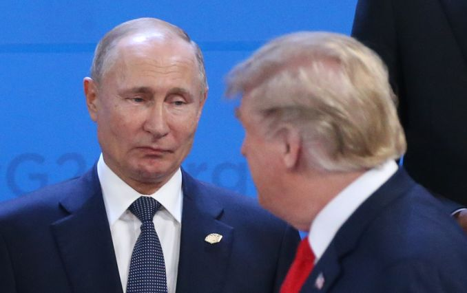 Trump+and+Putin+during+a+previous+G20+Summit%27s+Plenary+Meeting+on+November+30+to+discuss+a+nuclear+deal.+