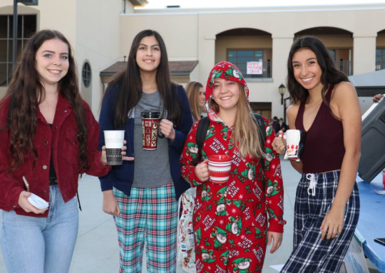 YLHS students enjoy their hot chocolate in their holiday pajamas before school starts.