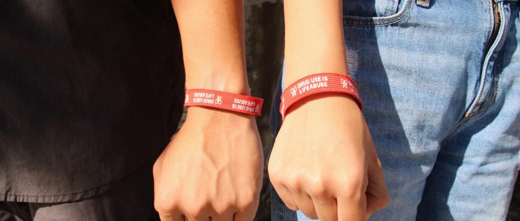 Matthew Serrao (12) and Jessica Ryan (12) wear their bracelets to show their support of being drug free.