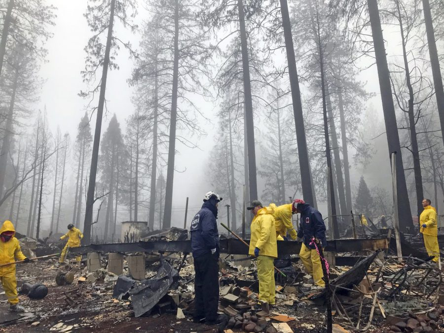 Volunteers help firefighters after the wildfire in Paradise, CA.