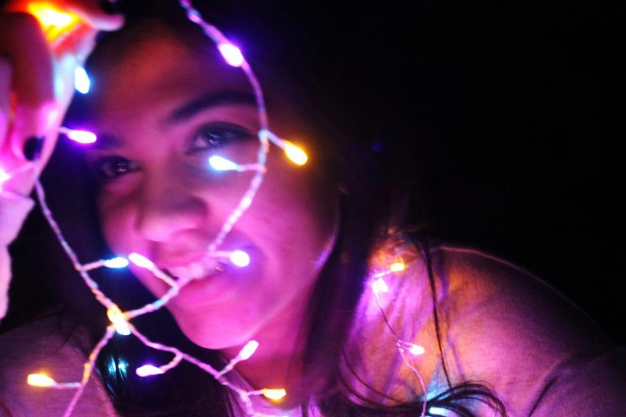 A picture of me in 2019 already choosing to be happier on my day in by playing with my fairy lights and taking funny pictures. Success in the little things.