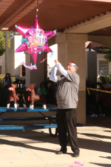 Mr. Flynn (S) finally hits the piñata.