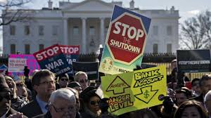 People protesting to stop the shutdown.