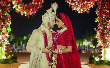 A picture of Priyanka Chopra and Nick Jonas in classic Indian wear before their wedding.