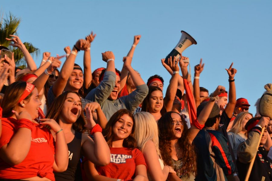 The Stable shows their school spirit at a Friday night varsity football game.