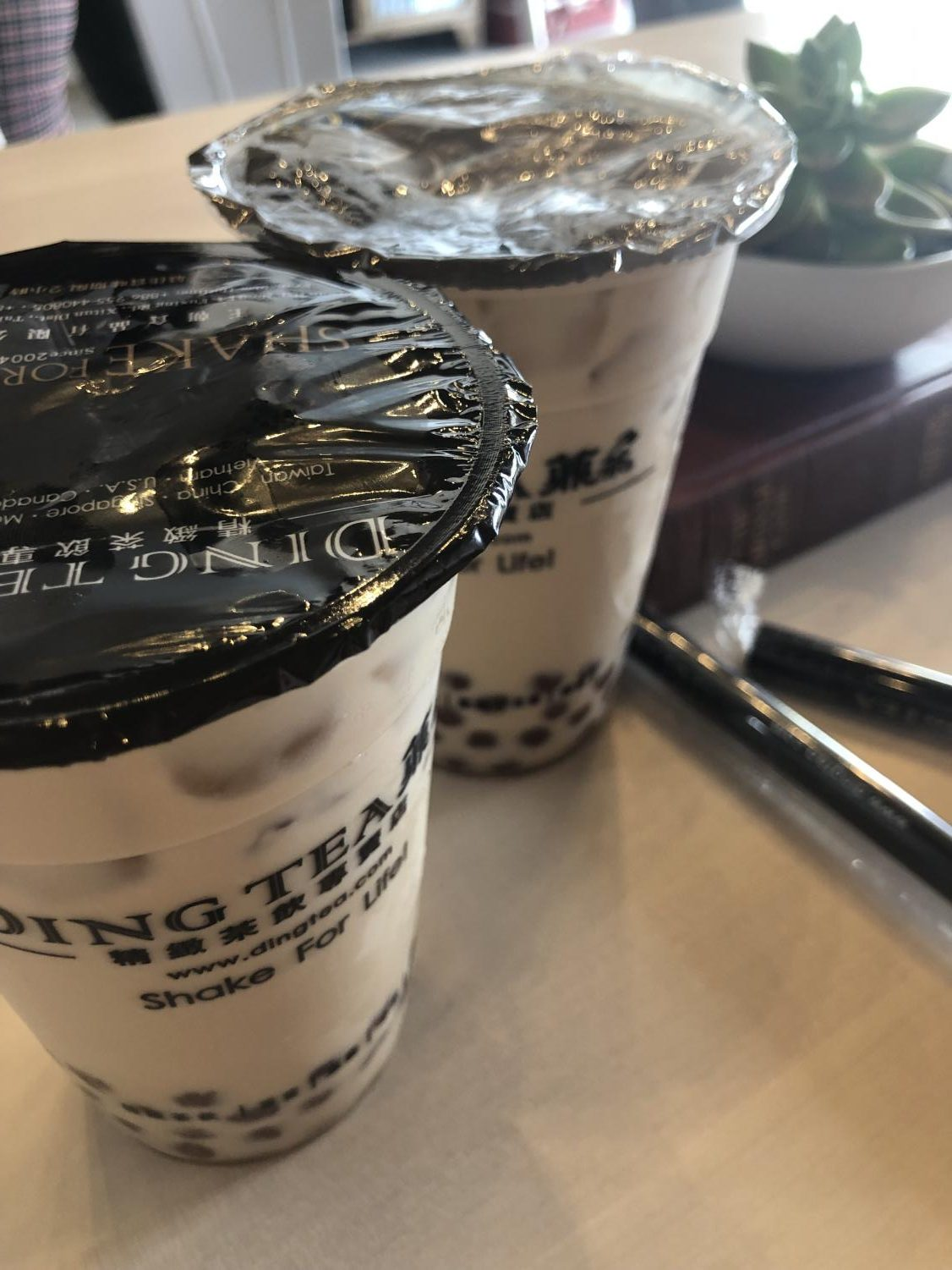 Shown above is an image of Ding Tea's delicious classic milk tea with boba.