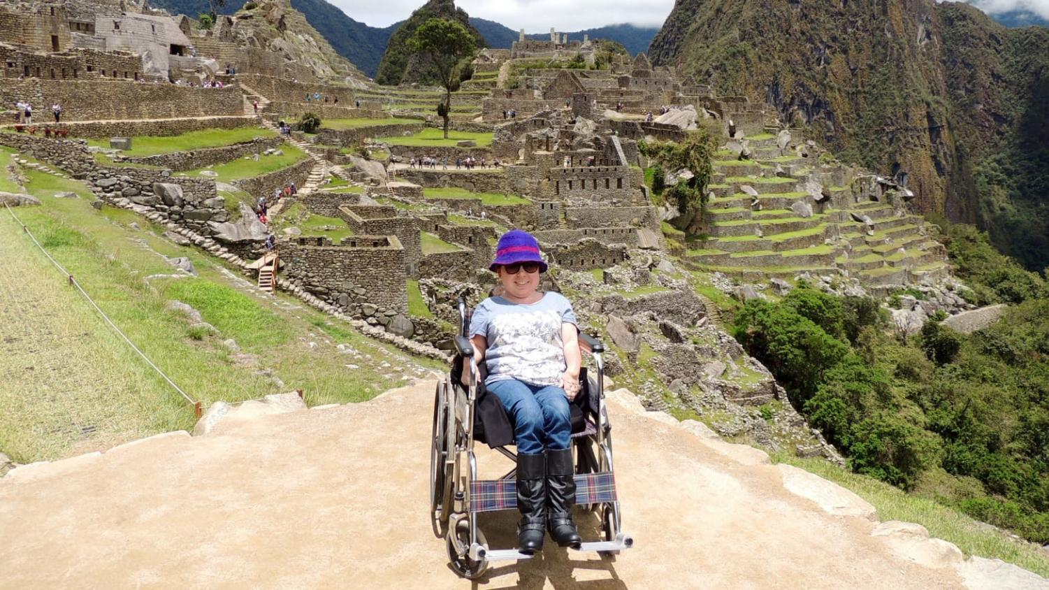 CIndy Otis, a wheelchair user, scaled the Incan ruins of Machu Picchu.