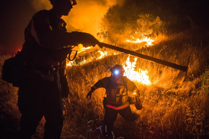California firefighters do work to contain and extinguish the Ranch Fire near Upper Lake, California.