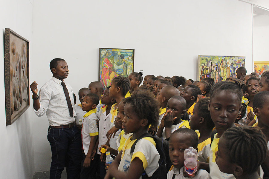 Students are shown touring an art museum in Congo.