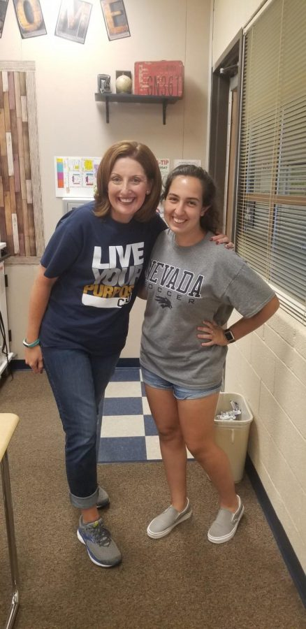 Emma Khamo (11) poses excitedly with her club advisor, Mrs. Shay (Staff). They are thrilled to be planning their coming events and activities for the Chick-Fil-A Leader Academy.