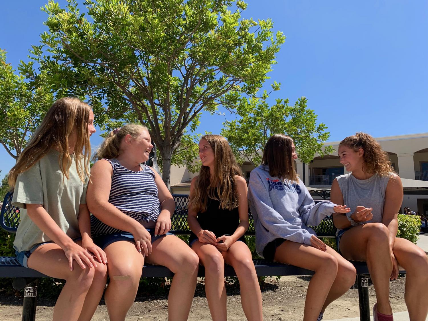 Freshman students exchange laughter, stories, and funny comments to each other.