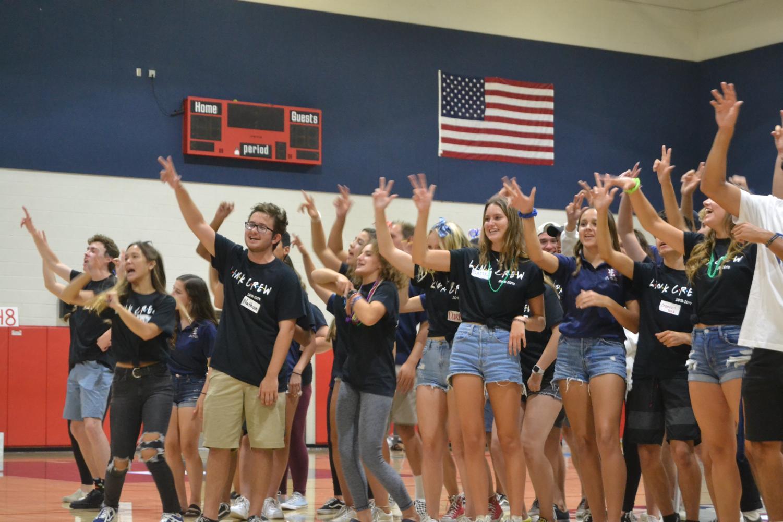 Link Crew Leaders at Freshmen Orientation over the summer teaching freshmen YLHS cheers