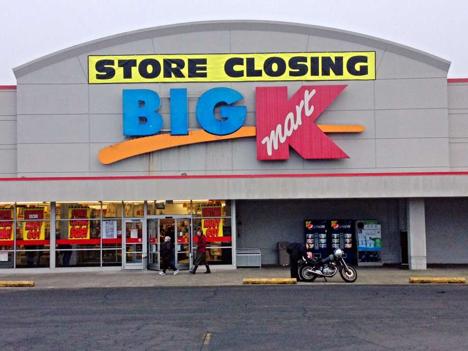 A store closing sign lies above a Big Kmart sign in Seattle, WA during January 2013. Less than 300 Kmart and Sears locations will be open throughout the country starting in 2020.