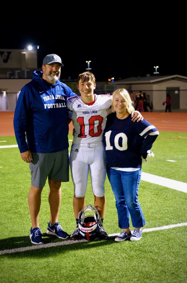 Rhys Weingarten (12) after a football game with his parents