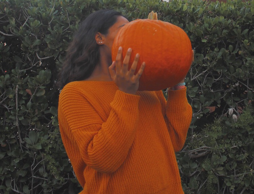 Halloween+color+themed+photo+of+Karina+Shah+with+a+pumpkin.+