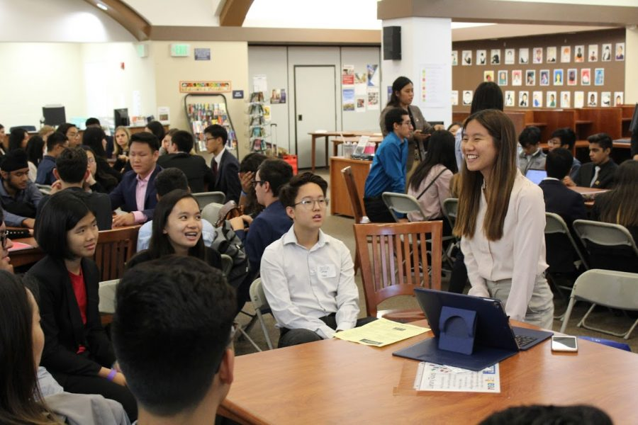 Sarah Chen (12), president of YLHS FBLA, leads a discussion during the Round Table about membership.