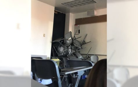 Students stacked chairs to block a door to classroom at CSU Long Beach.