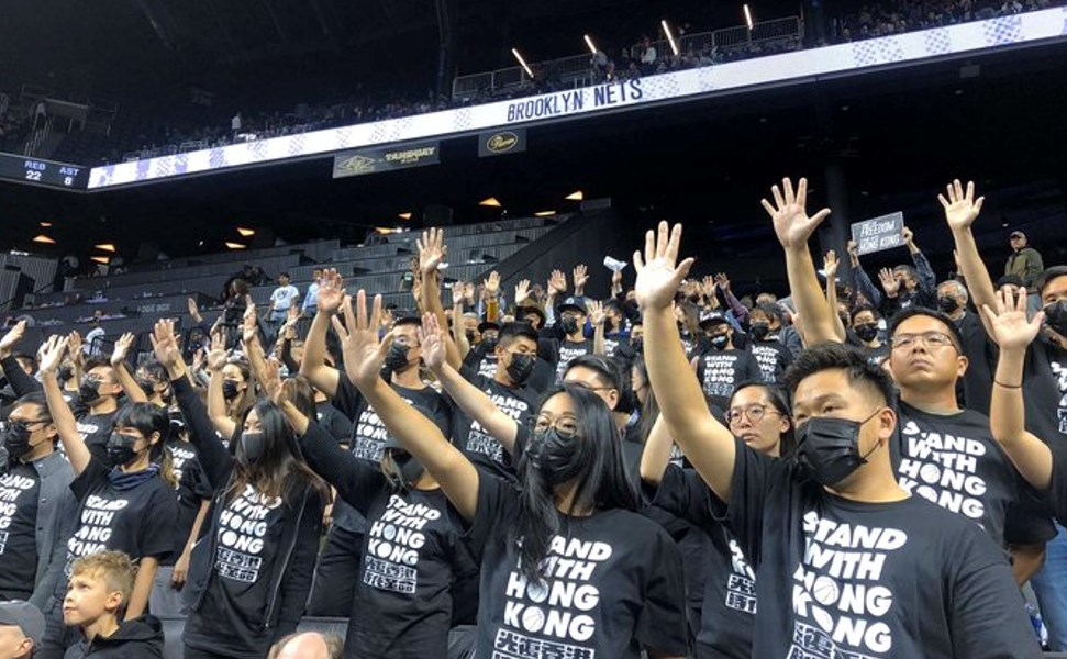 Supporters of Hong Kong protesting the Brooklyn Nets NBA game.