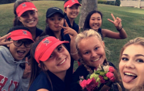 Some of the ladies from the Women's Varsity Golf team smile before they head out onto the green to face their opponents.