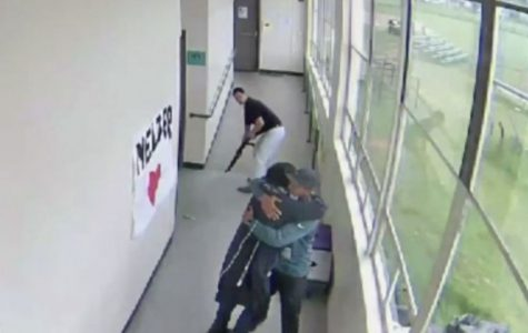 A still from security camera footage showing Keanon Lowe hugging Angel Granados-Diaz.