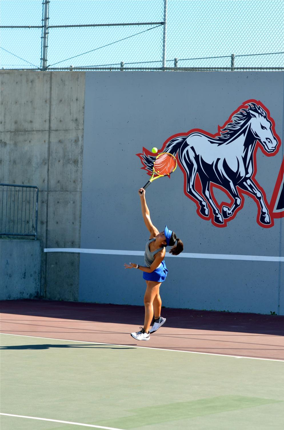 With confidence and pride, Brionna Nguyen (10) proves to have an exemplary approach as she serves to her opponent.
