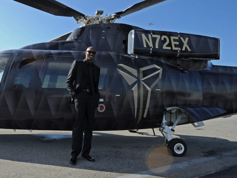 Kobe Bryant alongside his privately owned Sikorsky helicopter that crashed on Sunday.