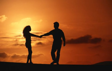 A cute date setting with two people dancing into the sunset.