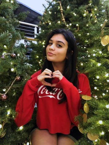 This is a picture of me after going out with my friends for our Christmas photoshoot where I am surrounded by Christmas lights.