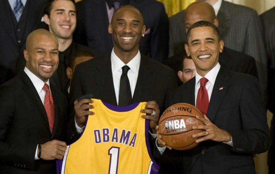 Barack Obama (right), former president, alongside 2008-2009 NBA Champions Derek Fisher (left) and Kobe Bryant (center)