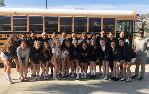 The team prepares to travel to Rancho Cucamonga and play they second round game by taking a team photo in front of their team bus.