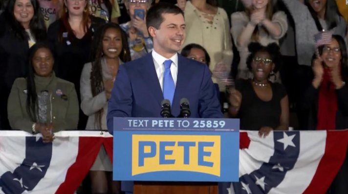 Pete+Buttigieg%2C+surrounded+by+devoted+supporters%2C+speaks+on+his+placement+of+the+Iowa+caucus.+